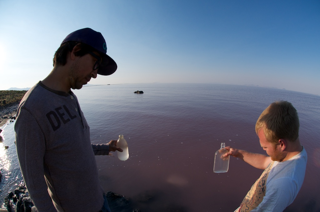 Adrian and Will bottling water at the Rozel Point, Great Salt Lake, Utah.