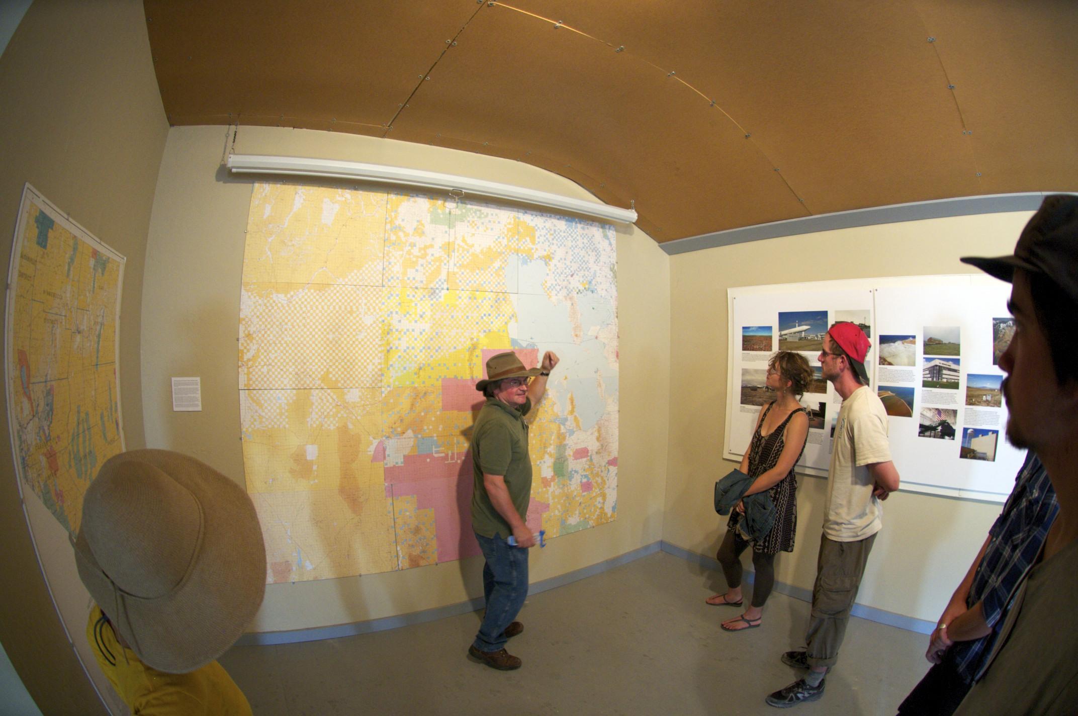 Matt Coolidge talking about the BLM land status map in Wendover, Utah.