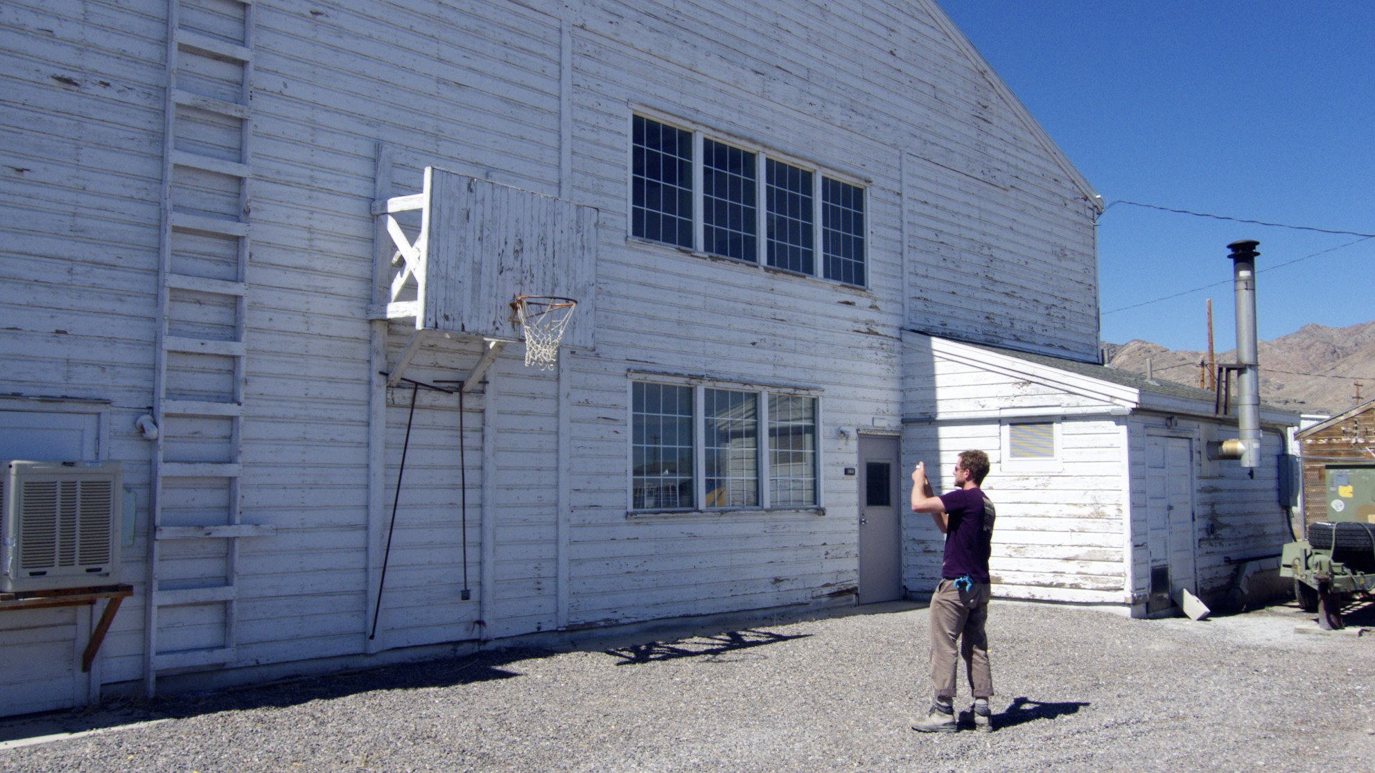 Ted Carey documenting a found hoop on the flight line in Wendover, Utah.