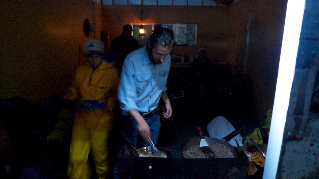 Carl cooking in Red Dog Shed - out of the rain, Madrid, New Mexico.
