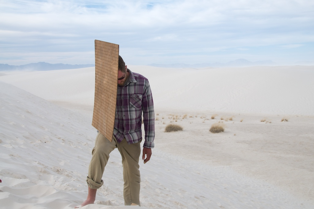 Ted Carey with peg board and wind, White Sands National Monument, New Mexico.