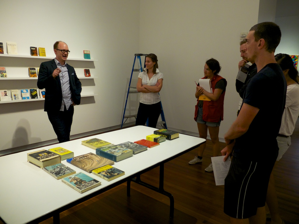 Conrad Bakker talking about his work creating wooden reproductions of Robert Smithson's library during installation at the Utah Museum of Fine Arts, Salt Lake City, Utah.