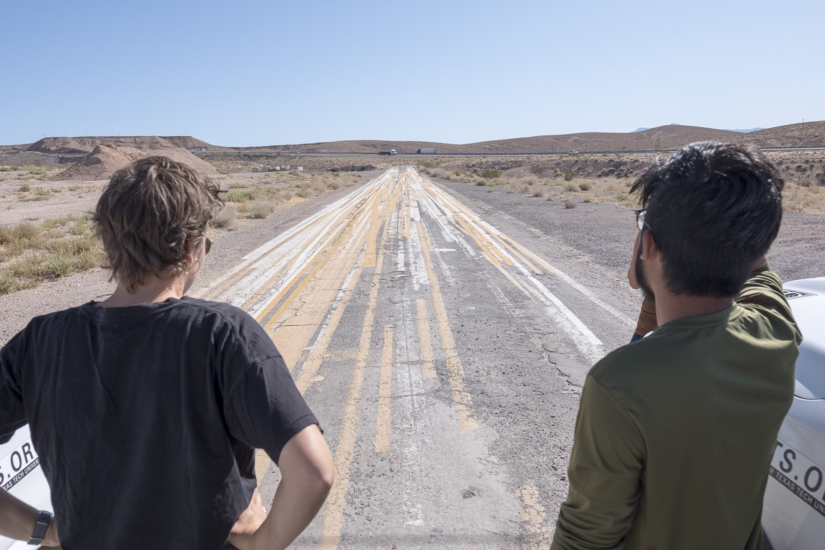 Investigating highway line painting, Logandale, Nevada. Photo by Chris Taylor. 20190920_105549_landarts_cjt.jpg